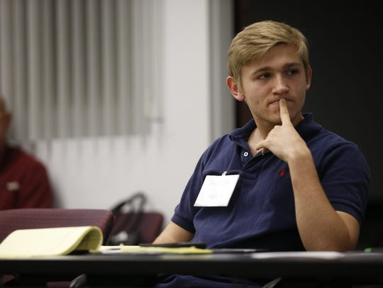 Joseph Levore listens to fellow students during the