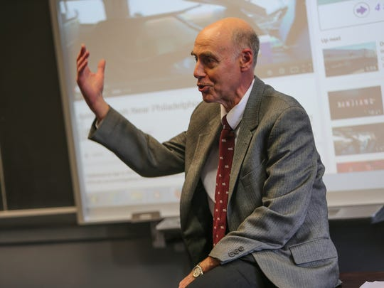 University of Delaware professor Allan Zarembski discusses Sunday's Amtrak crash during his introduction to railroad engineering class Thursday.