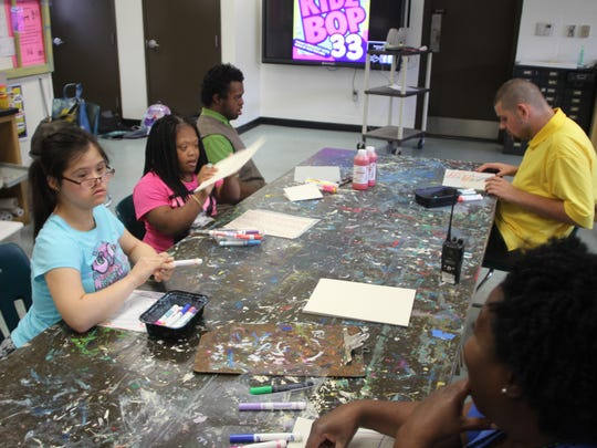 Gretchen Everhart School's teen students, a few of which are shown here in art class, will soon have their own park on the school's campus.