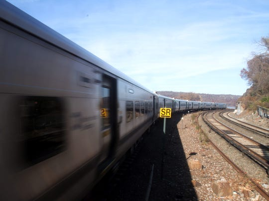 A southbound Metro-North train rounds a bend at Spuyten Duyvil in the Bronx as it approaches the Metro-North station Nov. 25, 2017. Four years earlier, a southbound train derailed coming around the same bend, killing four passengers.