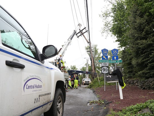 In this file photo, a Central Hudson crew works to replace damaged utility pole at the intersection of Osbourne Hill Road, Jackson Street and Baxtertown Road in Fishkill on May 17, 2018.