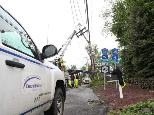 A Central Hudson crew works to replace damaged utility pole at the intersection of Osbourne Hill Road, Jackson Street and  Baxtertown Road in Fishkill on May 17, 2018.
