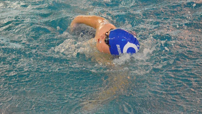 Carlsbad's  Aiden Brunnemann competes in the boys 100-yard freestyle at the Carlsbad Invitational on Saturday.