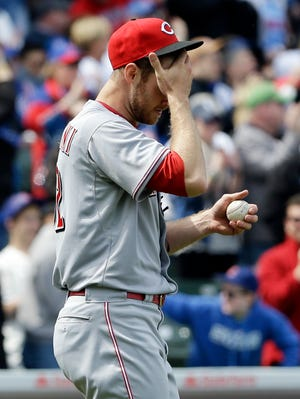 Cincinnati Reds starter Tony Cingrani wipes his face after Chicago Cubs' Mike Olt hit a solo home run.