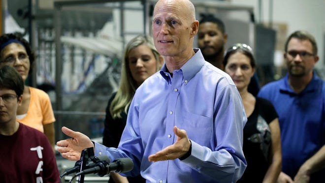 Florida Gov. Rick Scott speaks at Beneficial Blends in Tampa Jan. 25. Despite what could be a bruising budget year with competing priorities, Scott called for $618 million in tax cuts, including a dramatic cut in the sales taxes charged on commercial rents.