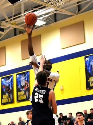 Zubi Nwankwo drains a jumper for Walnut Hills over the West Clermont defense, Jan. 19, 2018.