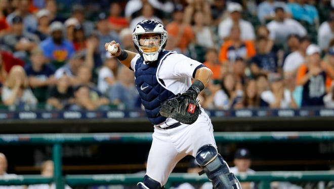 Detroit Tigers catcher Alex Avila throws to first base to complete a double play against the Arizona Diamondbacks in the eighth inning of a baseball game in Detroit, Tuesday, June 13, 2017.