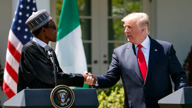 President Trump shakes hands with Nigerian President Muhammadu Buhari during a news conference in the Rose Garden of the White House Monday.