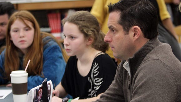 Sophie Soloway, 12, and Caley Doell, 11, listen during a roundtable workshop Feb. 11, 2014 at Copper Beech Middle School about how Common Core is affecting students.The event was sponsored by State Senator Greg Ball and attended by 70 students, parents and educators.