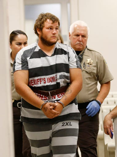 Leslie Allen Merritt Jr., 21, makes his initial appearance before a judge at the Maricopa County Sheriff's Office 4th Avenue Jail on Sep. 19, 2015 in Phoenix. Arizona Department of Public Safety Director Frank Milstead said Merritt Jr. is accused of being linked to at least four of 11 shootings incidents on Interstate 10 in Phoenix.