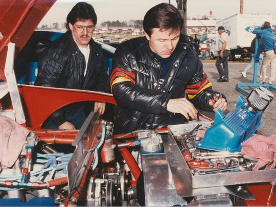Owner/driver Alan Kulwicki and Joe Covington, a longtime weekend warrior on Kulwicki's crew, work on Kulwicki's car in this undated file photo.