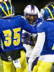 Newark High product Taylor Reynolds greets Delaware defensive backs Khaliq Gatson (William Penn, left) and Ray Jones (Hodgson), after the Blue Hens' 24-21 loss at Delaware Stadium Saturday.