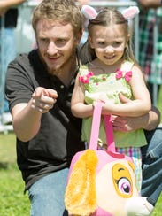 William Zimmerman and his daughter Serenity, 3, get