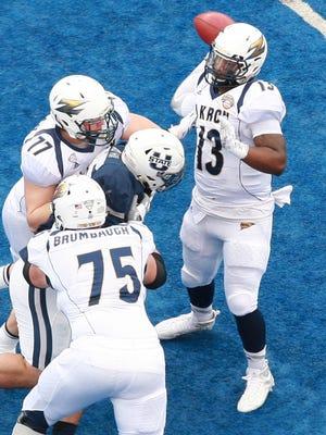 Akron Zips quarterback Thomas Woodson throws during the first half of the 2015 Famous Idaho Potato Bowl at Bronco Stadium.