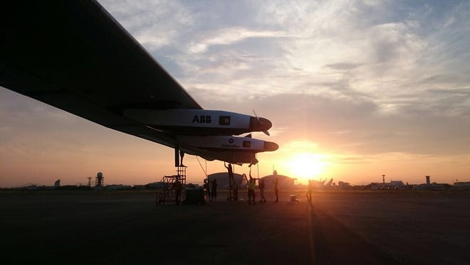 This handout photo taken on June 2, 2015 by the Solar Impulse project shows the Swiss-made solar-powered plane Solar Impulse 2 being tied down by ground crew the day after the unexpected intermediate landing in Nagoya, Japan due to worsening weather conditions.