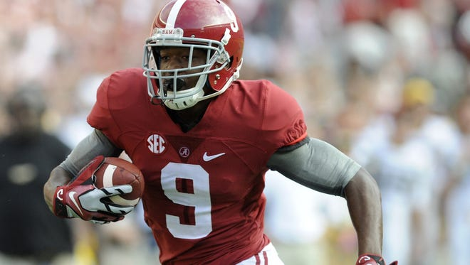 Alabama wide receiver Amari Cooper rambles in for a first-quarter touchdown. Alabama wide receiver Amari Cooper (9) rambles in for a first quarter touchdown against Southern Miss at Bryant Denny Stadium in Tuscaloosa, Ala. on Saturday September 13,  2014.