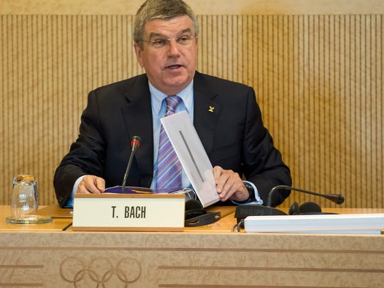 International Olympic Committee, IOC, President Thomas Bach of Germany, waits prior to the opening of the executive board meeting at the IOC headquarters in Lausanne, Switzerland, on Monday, July 7, 2014. (AP Photo/Keystone,Jean-Christophe Bott)