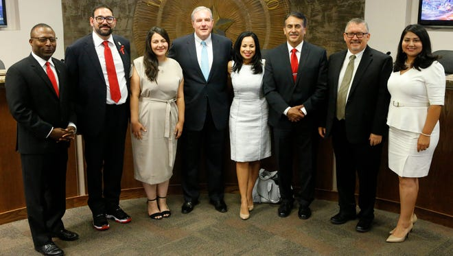 City Council representatives and Mayor Dee Margo pose at the end of their first meeting. City Rep. District 4 Sam Morgan, city Rep. District 1 Peter Svarzbein, city Rep. District 2 Alexsandra Annello, Margo, city Rep. District 6 Claudia Ordaz Perez, city Rep. District 7 Henry Rivera, city Rep. and Mayor Pro-Tem Michiel Noe and city Rep. District 3 Cassandra Brown are shown in 2017.