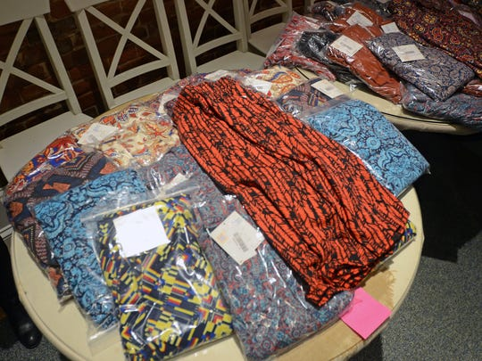 Unique leggings fill a row of tables Sunday, Jan. 31, during a boutique pop-up shop featuring LuLaRoe clothing by Suzy and Steph at Kate's Downtown.