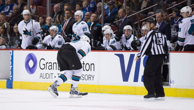 San Jose Sharks center Joe Thornton skates to the bench with an injury during the first period on Sunday.