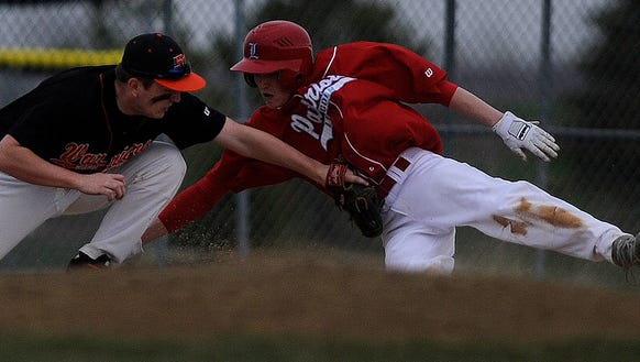 Lincoln's Nolan Burchill (right) tries to beat the