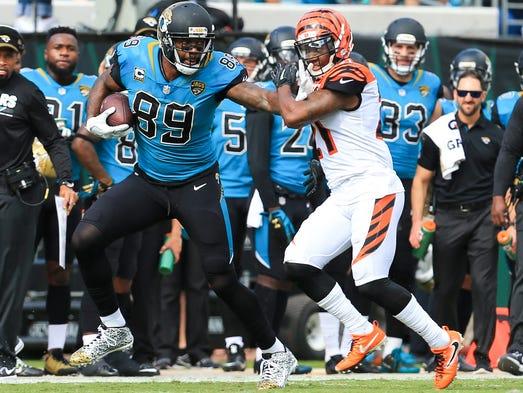 Jacksonville Jaguars tight end Marcedes Lewis stiff-arms