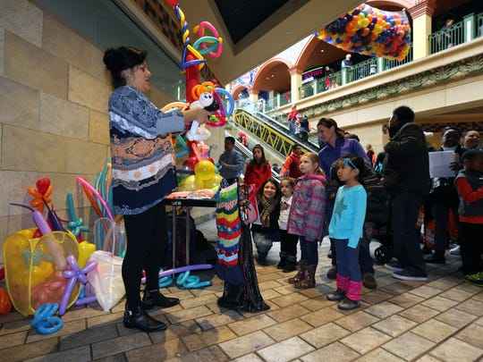 "Children watch as Liliana Benitez makes balloon animals at the ""Ring in the New Year at Noon"" at New Roc City in New Rochelle, Dec. 31, 2016. The 7th annual event, benefiting the Westchester Children's Museum, included a ballon drop at noon, giveaways, activities and a meet and greet with New York Ranger alum, Ron Greschner."