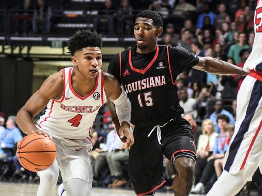 Mississippi's Breein Tyree (4) is defended by Louisiana-Lafayette's P.J. Hardy (15) during an NCAA college basketball game in Oxford, Miss., Friday, Nov. 10, 2017.