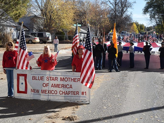 Members of the local chapter of the Blue Star Mothers of America line up for the Veterans Day parade Saturday in Aztec.