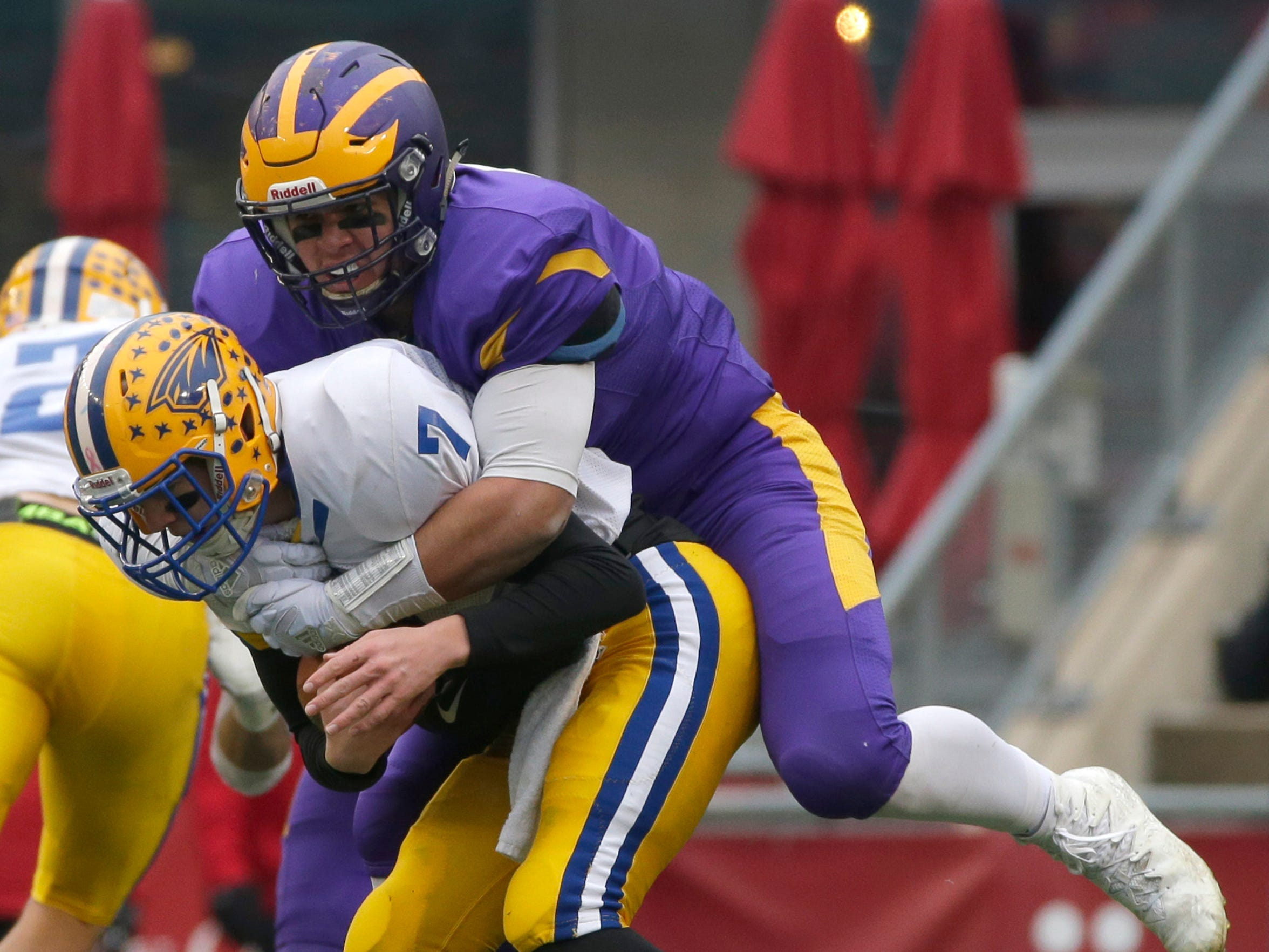 New Berlin Eisenhower defensive lineman Mark Shields sacks Rice Lake quarterback Peyton Buckley in the second quarter during the WIAA Division 3 state football championship game.
