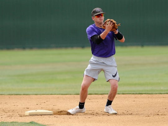 Hardin-Simmons senior shortstop Taylor Cooling comes across the second base bag during double play drills at the Cowboys' practice on Wednesday, May 2, 2018. Earlier this season Cooling broke the HSU school record for doubles in a career and now has 56 entering the American Southwest Conference tournament on Friday in Alpine.