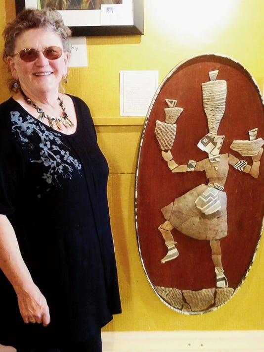 "Rita Sherwood with her 3-D Sculpture titled ""Homage to She Who Makes the Pots."" This entry in the Grant County Art Guild's Members Opening Show was judged as the ""Best of Show""Ê in crafts. Courtesy Photo"