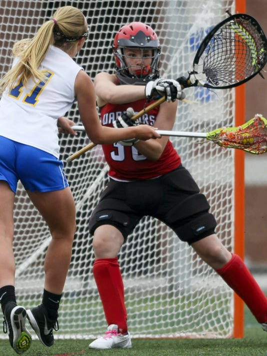 Kennard-Dale's Emmie Dressel, left, scores on Susquehannock goalie Amber Orner during the District 3 girls' lacrosse tournament third-place game Thursday at Lower Dauphin Middle School in Hummelstown. Dressel scored five goals to help Kennard-Dale earn a 15-11 and secure a spot in the PIAA tournament.