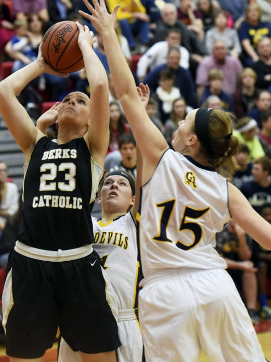 Greencastle-Antrim's Katie Gelsinger, right, goes for a block against Courtney Wensel of Berks Catholic. Wensel scored 12 points, and the Saints won 53-45 in the second round of the PIAA Class AAA Championships on Wednesday.