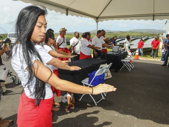 A cultural blessing is performed during a ribbon cutting ceremony for NRG Renew's Dandan Solar Project in Inarajan on Wednesday, Oct. 7.