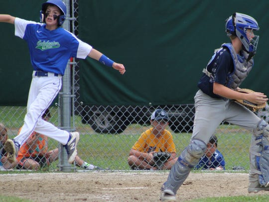Jackson McBride scores on Zach Davis' two-run single during during Saturday's 11-12-year-old District I Little League championship game.