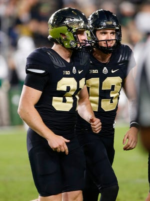 Purdue kicker Spencer Evans, right, celebrates with teammate Joe Schopper after his field goal in the fourth quarter against Ohio Friday, September 8, 2017, at Ross-Ade Stadium. Purdue defeated Ohio 44-21.