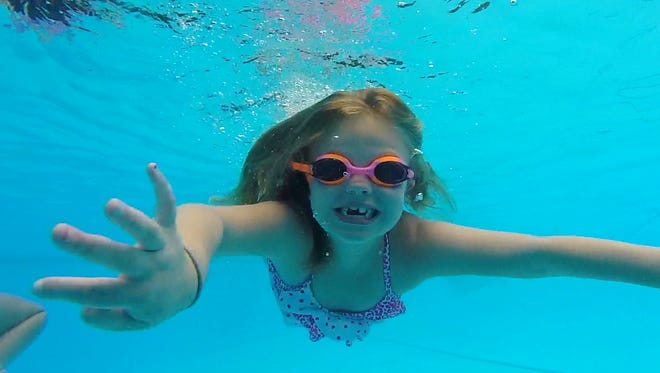 Giovanna Agnelo, 6, of Tappan swims at the Tallman Pool and Beach Club last week.