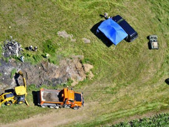 Investigators used digging equipment and dump trucks