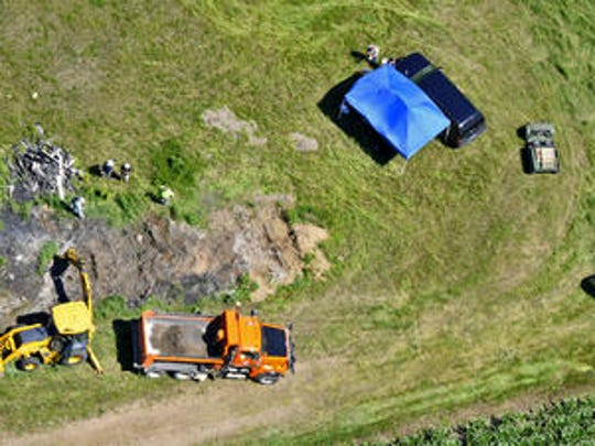 Investigators used digging equipment and dump trucks to search Dan Rassier's property in July 2010 for evidence in the Jacob Wetterling investigation.