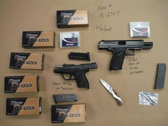 636633727285596843-gun-arrest.jpg