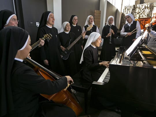 "Members of ""Siervas,"" a Peruvian-based rock 'n' roll band comprised entirely of Catholic nuns rehearse a day ahead of their performance at the Christ Cathedral campus in Garden Grove, Calif."