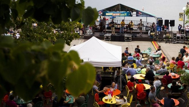 People enjoy food, drinks, and music on the Memorial Union Terrace last summer as renovations continue.