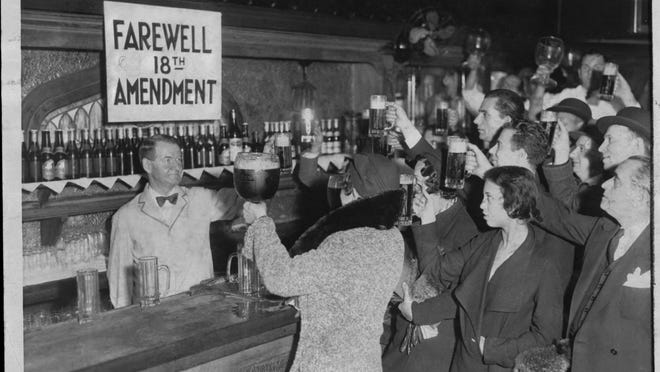 Speakeasy patrons offer a farewell toast to Prohibition, which began in 1920 and ended in 1933.