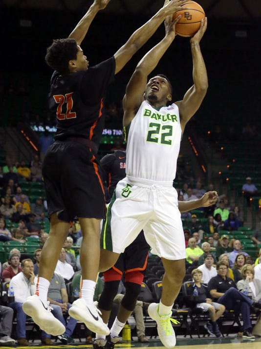 Baylor guard King McClure (22) shoots against Sam Houston State guard Marcus Harris (22) during the first half of an NCAA college basketball game in Waco, Texas, Monday, Dec. 4, 2017. (AP Photo/LM Otero)
