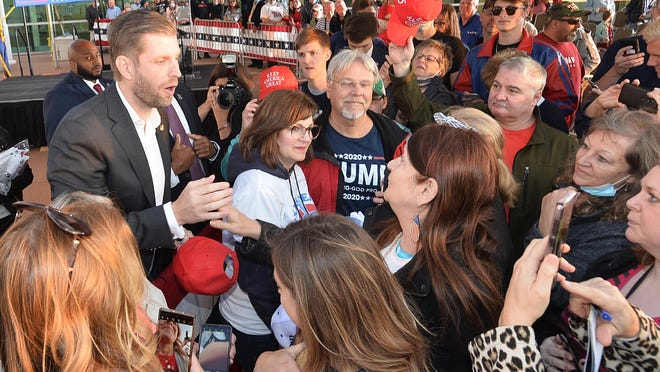 Eric Trump, top left, greets well-wishers following a rally Monday  in support of his father, President Donald Trump, under a tent outside the Bayfront Convention Center in Erie.