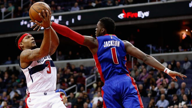 Bradley Beal #3 of the Washington Wizards puts up a shot in front of Reggie Jackson #1 of the Detroit Pistons in the second half at Verizon Center on March 14, 2016 in Washington, DC.
