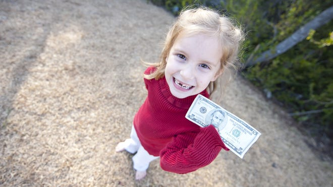 The Tooth Fairy is leaving 8% less this year, according to a survey from Visa out Thursday.