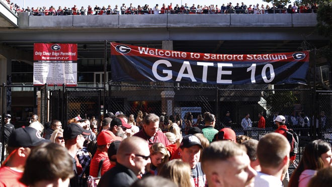 Georgia fans wait for the start of the Dawg walk before a game against Massachusetts in Athens on Nov. 17, 2018.