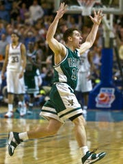 Vermont's T.J. Sorrentine celebrates Vermont's 60-57 overtime victory over Syracuse in the first round of the NCAA Tournament at the DCU Center in Worcester, Mass. on Friday, March 18, 2005.